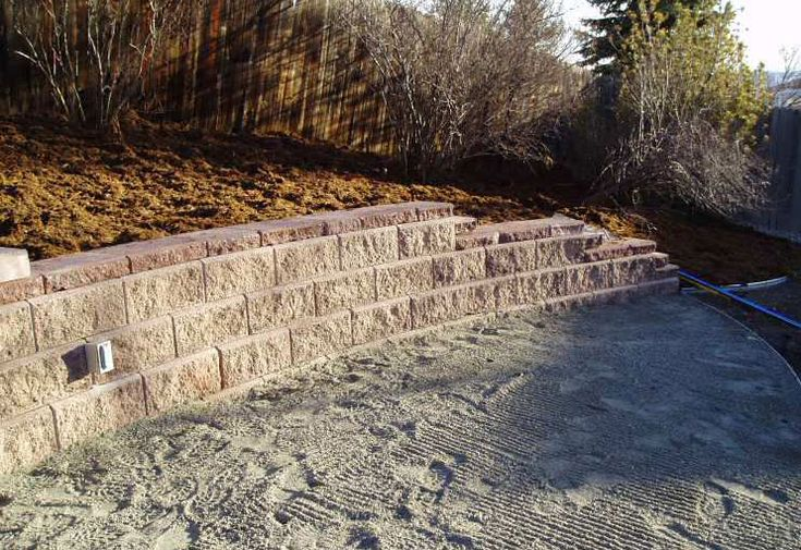 Building a retaining wall with a drainage system is one way to make your property more usable especially if you have sloped portions of land. Retaining walls prevent erosion and divert rainfall runoff. Doing so makes more of your land usable for gardening or as living space and increases property value over the long term.