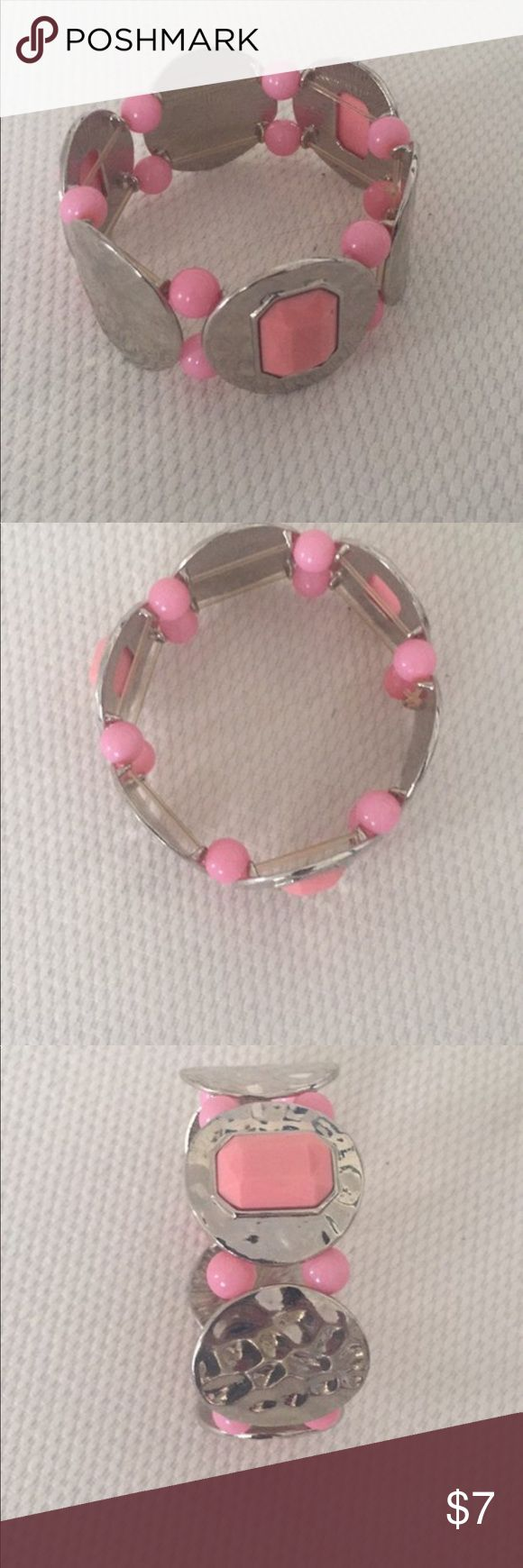 Wallis UK Silver Hammered Metal Bangle Wallis UK Silver Hammered Metal Bangle with Pink accents. One Size fits most. Stretchy clear nylon on the inside. No flaws. Wallis Jewelry Bracelets