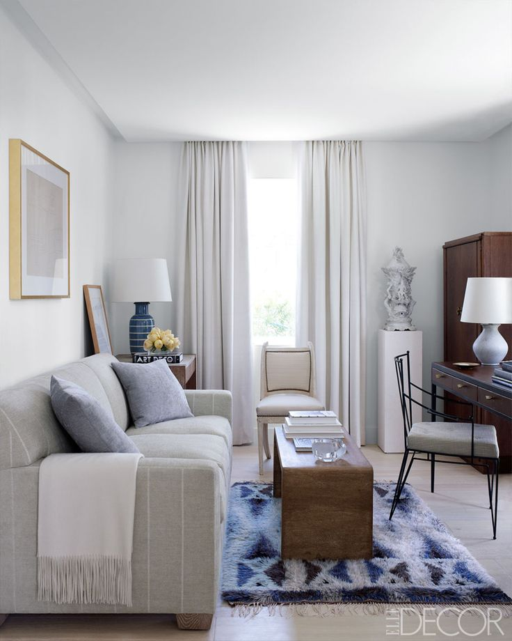 picking the perfect sofa, living room, elle decor, indigo, striped linen sofa, blue striped lamp, art deco book, yellow tulips, white drapes, bent wood coffee table, desk in living room, metal chair