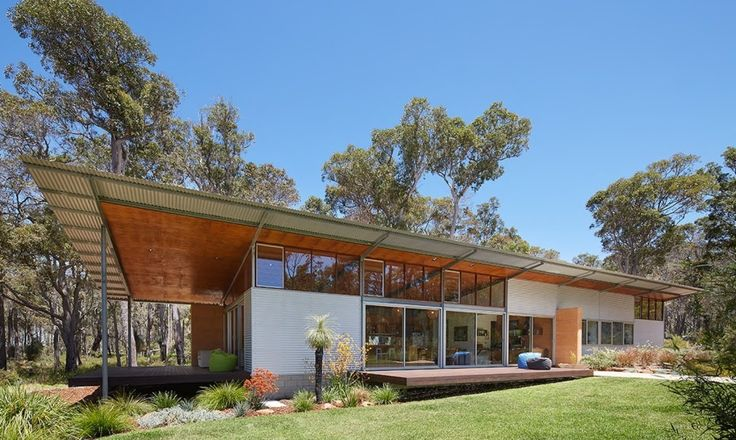 Built for minimal maintenance, the 168-square-meter Bush Home was constructed with prefab steel frames and clad in zincalume steel and large windows.