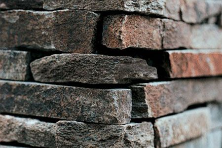 Rock veneer adds depth and texture to walls, foundations, and chimneys