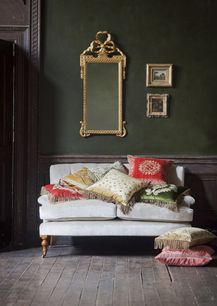 The Emily is a charmingly shaped small sofa, with subtly curved lines and a beautifully deep-buttoned back. Shown in Capri Silk Velvet - Stone, decorated with a selection of our couture, hand-embroidered cushions.