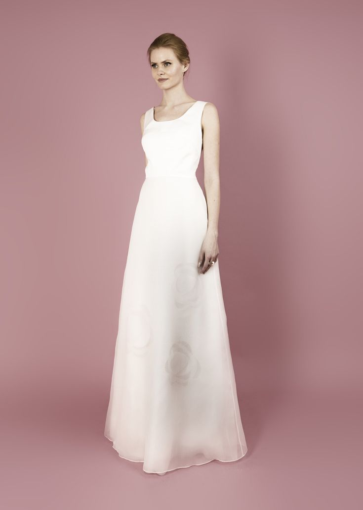 Modern wedding dress for the contemporary bride. Grace dress. Silk organza and moroccain dress with flower cutouts.