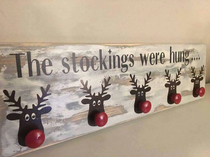 Clever stocking holder idea out of basic wall hanging coat rack with reindeer for Christmas