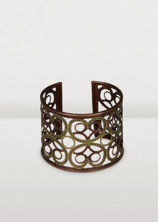 A stunning engraved cuff to add beauty to your day. Each bracelet is handcrafted from brass and copper by twisting and turning pieces into a floral and dot pattern.