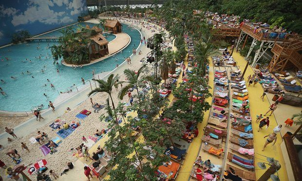 Krausnick Next time in Berlin: (60km) Visitors relax at the beach in the indoor Tropical Islands theme park, Krausnick, Germany - the glorification of kitschy
