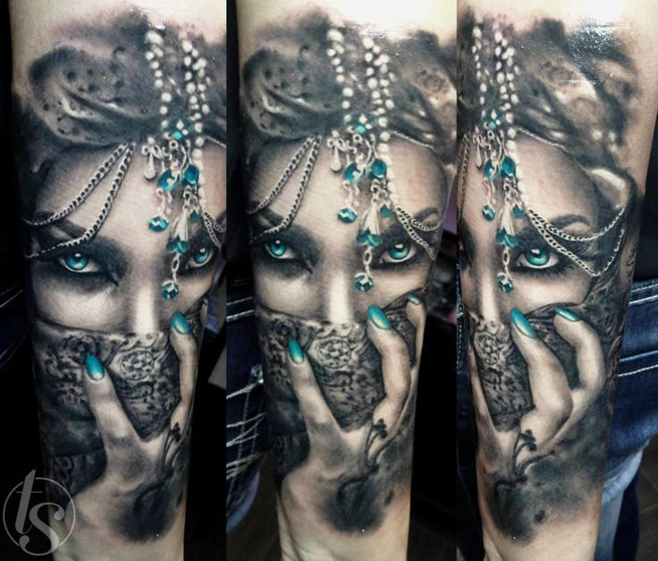 Woman mask black and blue tattoo by Zsofia Belteczky