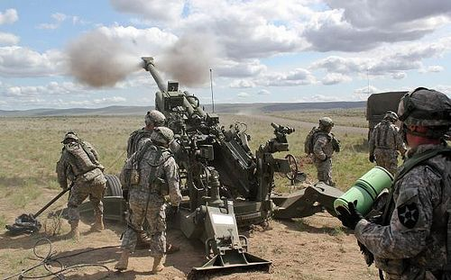 https://flic.kr/p/9M5Scn | Bringing in the big guns | Soldiers of 1st Battalion, 37th Field Artillery, 3rd Stryker Brigade Combat Team, 2nd Infantry Division, fire an M-777 Howitzer Artillery Cannon in response to a call for fire during a fire coordination exercise at Yakima Training Center in Washington.