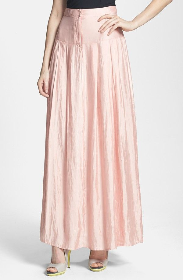Prepare to be romanced in this silky floor-sweeping maxi skirt softened with a petal-soft rose hue and billowing flared silhouette.