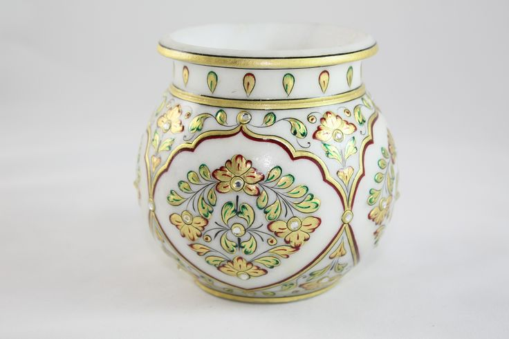 A hand painted piece of white marble pot with intricate floral designs available in various size.