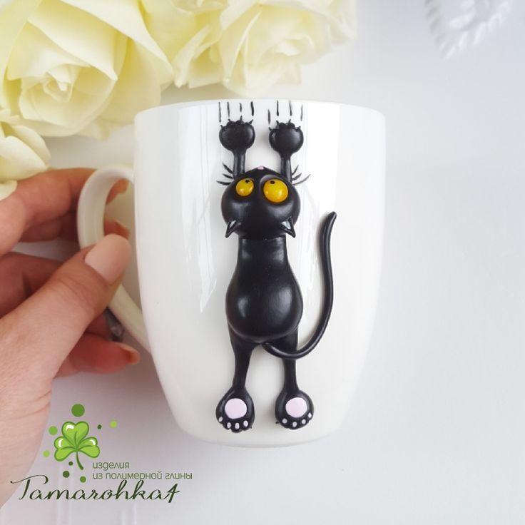 Черный и озорной котик!! Выполнен из полимерерй глины.