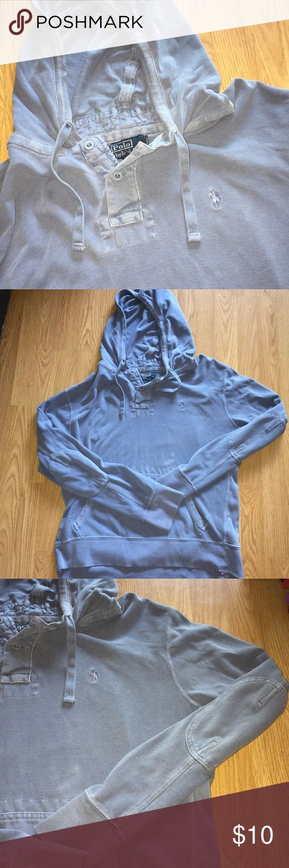 POLO Ralph Lauren pullover hoodie blue XL mens POLO. Ralph Lauren. Men's XL. Pullover with hood and pocket in front. Distressed blue color. This shirt has flaws that's why I am selling for cheap. There are several small holes near tag but when you wear it the holes are covered by the hood so unnoticeable. There is also some extra thread on the hood near both edges of the pockets. It could possible be cut off but I haven't tried. (See pics) ask questions Ralph Lauren Jackets & Coats…