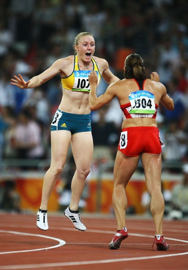 BEIJING - AUGUST 19: Priscilla Lopes-Schliep of Canada celebrates third place and Sally McLellan of Australia celebrates second place in the Women's 100m Hurdles Final held at the National Stadium on Day 11 of the Beijing 2008 Olympic Games on August 19, 2008 in Beijing, China. (Photo by Jeff Gross/Getty Images)