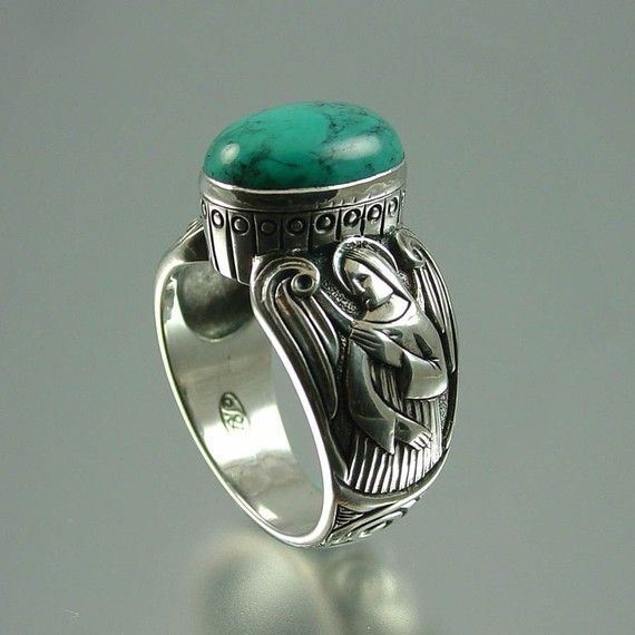 Turquoise Guardian Angels mens silver ring........  I don't care if it's a man's ring, I'd wear it anyway!