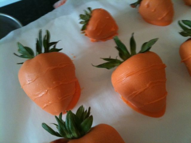 Food masquerading as other food - strawberries dipped in white chocolate (dyed orange) to look like carrots. This is so weird & gross.