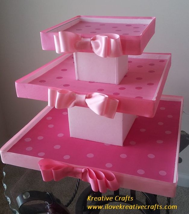 Baby shower cupcakes.  3 Tier holds 50 cupcakes.  I Love Kreative Crafts!