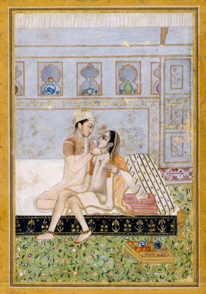 "Dipaka (Sanskrit dipa ""lamp"", ""light""). Love scene, night as other representations of the raga. On a shelf are arranged fruits and drinks. What would seem an object (lamp or incense burners) to the head of the bed (right side) should be in fact one of the four feet of the bed. Rajput, Provincial Mighal, 18th century."