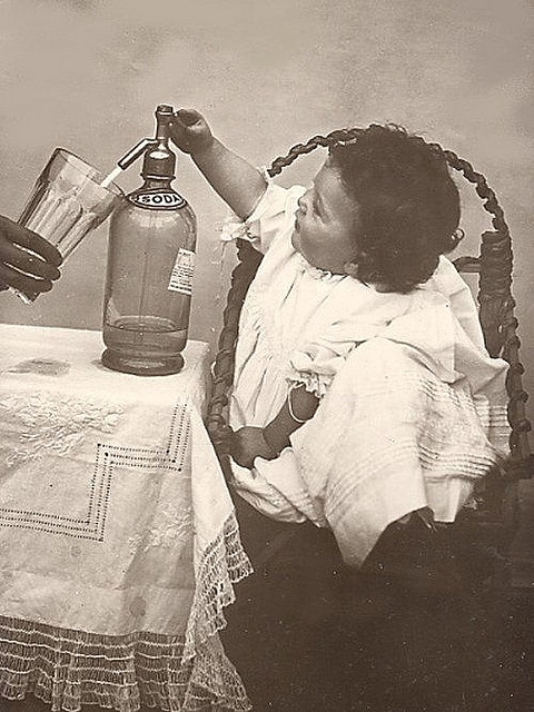 kid using an old seltzer bottle
