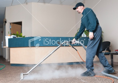 Lazy Boy Sofa Man steam cleaning the carpet of an office building