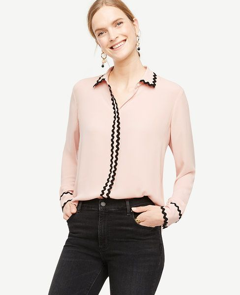 """Scalloped trim adds fresh texture play - and modern definition - to our timeless button down. Point collar. Long sleeves with pleated cuffs and button closure. Hidden button front. Back yoke with box pleat and side knife pleats. Shirttail hem. Zig zag trim at collar, placket and cuffs. 27 1/4"""" long."""