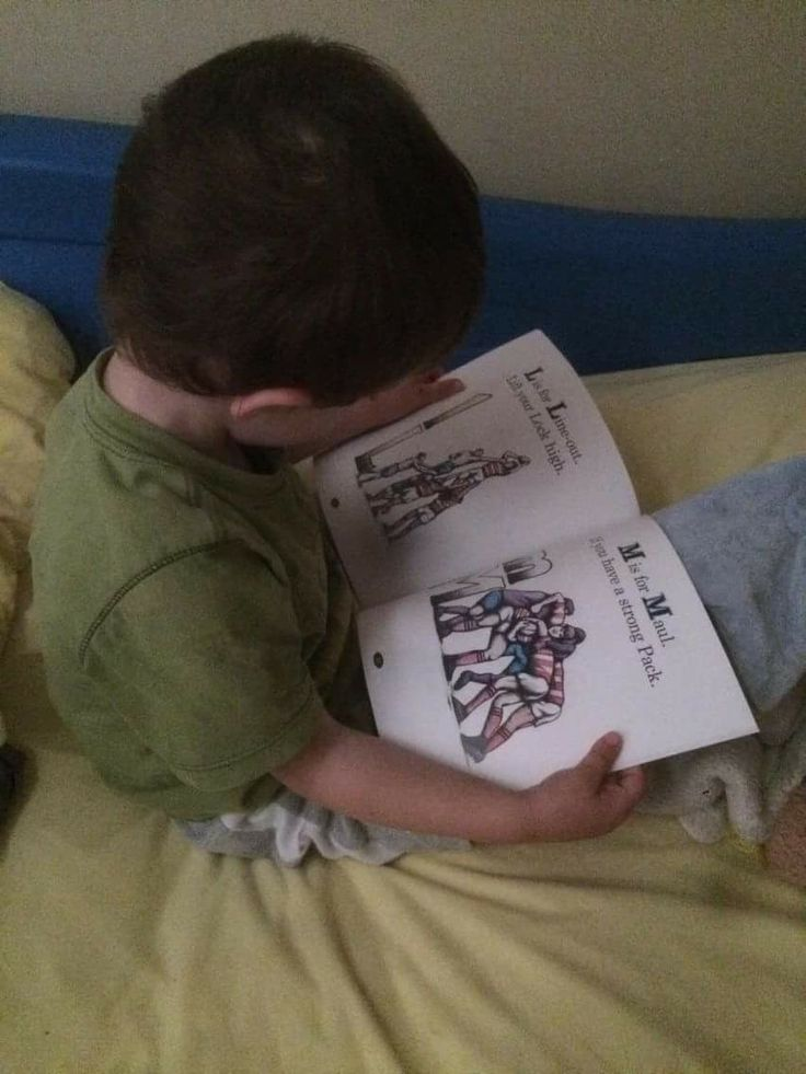 Delighted to see my friend from the #BytownBluesRugbyClub's son reading #MyRugbyABCBook. Especially love the reading-bottle drinking multi-tasking. Rugby is a game for thinkers after all!