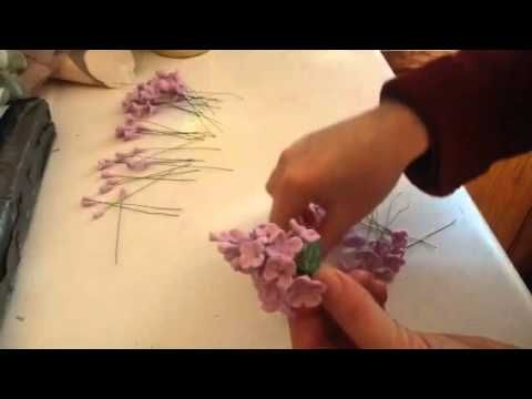 How to make gumpaste lilacs for cake decorating part 2, wiring the flowers together. https://www.youtube.com/watch?v=h-bipxhF3FY Cake decorating tips and tricks. Cake decorating tutorials.