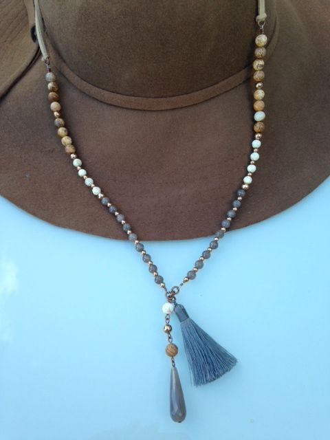Suede and bead bohemian necklace. My new fave!  http://www.xadajewellery.com/shop-by-collection/grey-mix-boho-suede-necklace-on-suede/