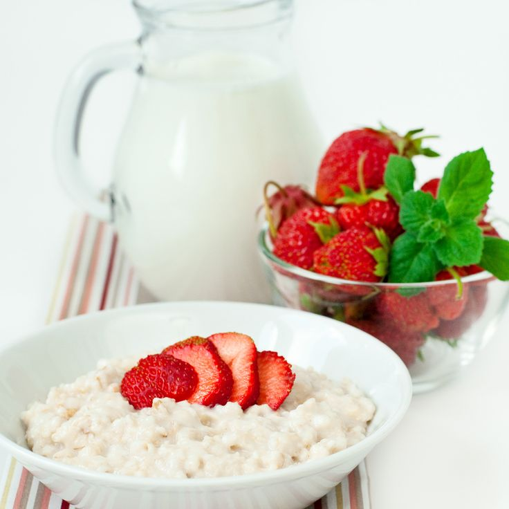 oatmeal porridge - Cereal with fresh strawberry and milk, selective focus, square image