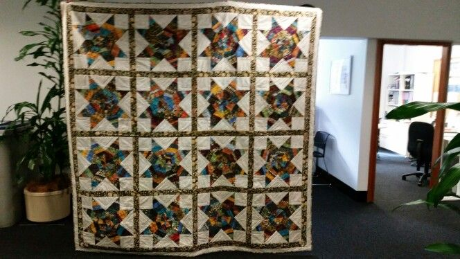 String of stars quilt for my son. It features batik fabrics bought in Jakarta. I think it's my best effort so far