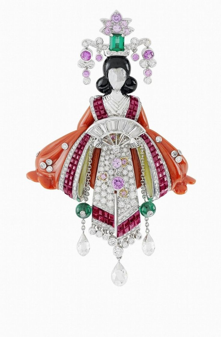 Van Cleef & Arpels. Palais de la chance High Jewellery collection. Lucky legends, Hina clip, white gold, diamonds, rubies, pink and mauve sapphires, emeralds, red gold, Mystery Set rubies, coral, black jade nephrite and rose-cut diamond face.