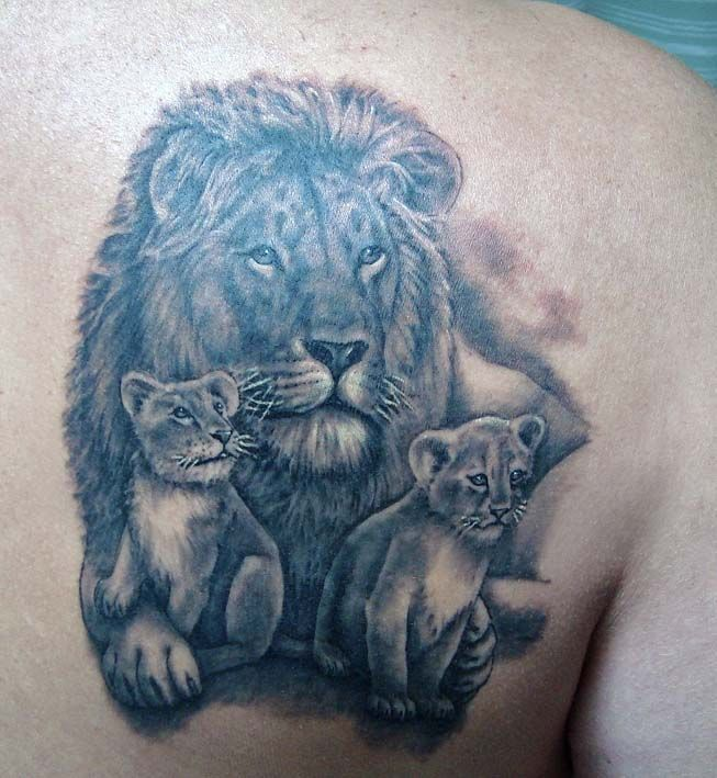 lion and cubs tattoo - nice tattoo for a mother to represent her and her kids