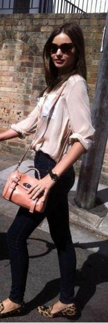Miranda Kerr in Nobody jeans, a Longines La Grande watch, Prada Heritage sunglasses and a Mulberry Mini Alexa bag in buffalo in Sydney.