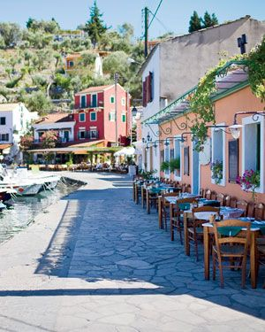 Paxos. Makes me laugh when the bus tries to get past this little taverna - quick shuffle your table in! Greece.