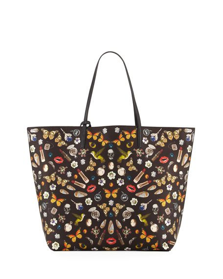 "Alexander McQueen printed lambskin shopper tote bag. Flat tote handles with hanging tassel and skull charm. Open top with snap closure. Inside, leashed zip pouch. 17.8""H x 17.8""W x 7""D. Made in Italy."