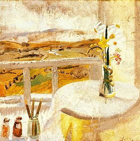 A landscape, mostly yellow, a white sky above; in the foreground a white railing and a white-covered table with a vase of yellow flowers