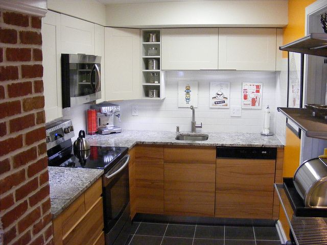 Adel white (AKA offwhite) cabinet doors on top and discontinued Solar Beech  doors on