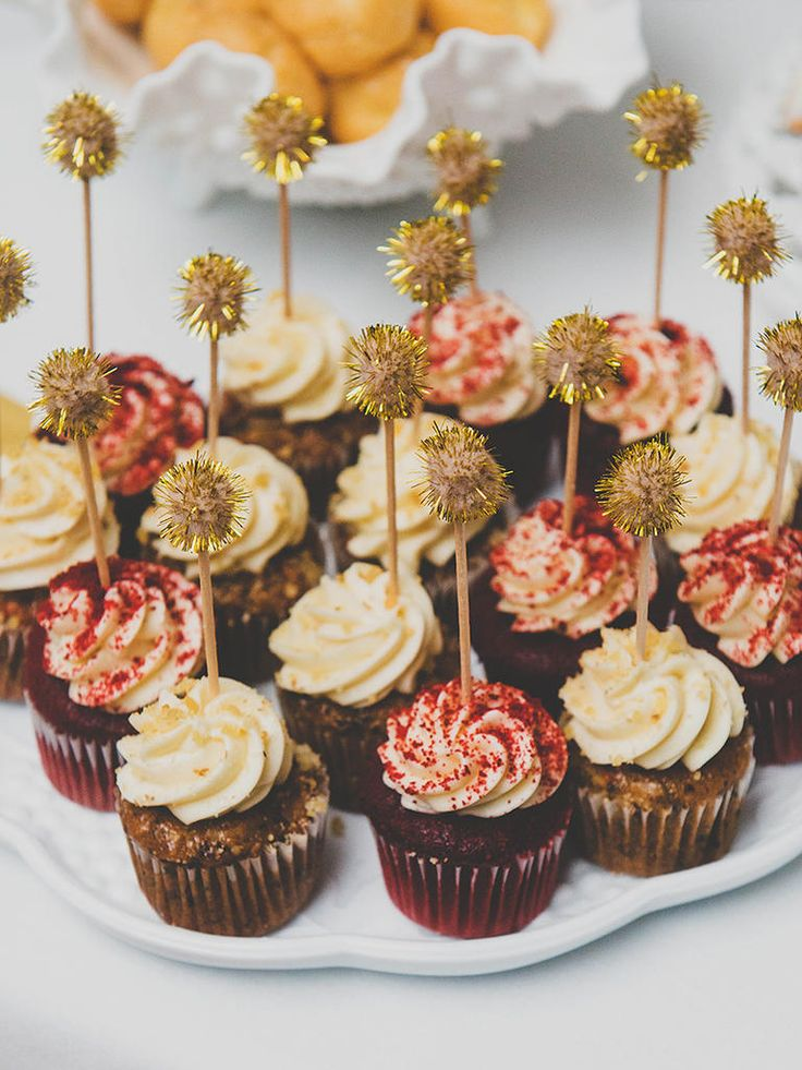 Wedding cakes aren't the only thing you can top! Dress up your cupcakes with festive toppers.