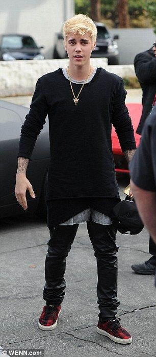 Sleek: Justin dressed in almost head to toe black for his appearance on Sunday, adding a p...