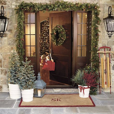 Vancouver Indoor/Outdoor Pre-Lit Garland---cute :)  I like the garland around the door frame..haha and the old sled, that's awesome!