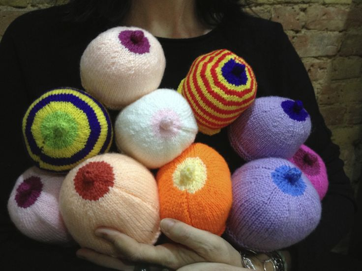 Knitted norks for the Breastfeeding team at the Brompton...