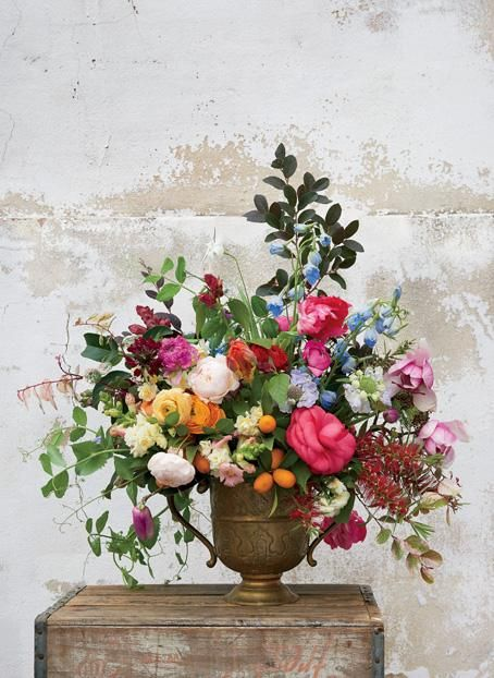 Japanese magnolias, late-blooming camellias, kumquats, loropetalum, and bottlebrush set off this Southern display by Pistil and Stamen, of New Orleans. | Photo by Alison Gootee | Garden & Gun Magazine