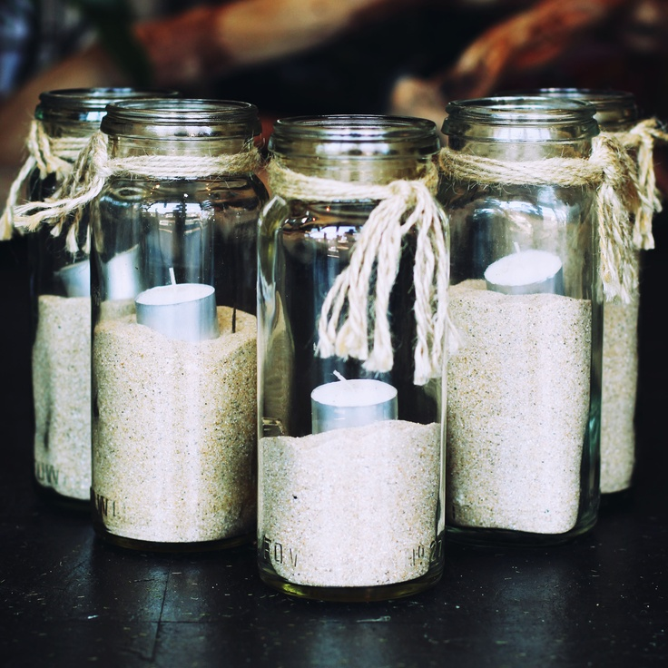 tall glass jars/sand/string/tealights - scatter to creat mood lighting on tables/pathways - suspend on string