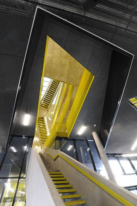 more of the yellow stairs...Science Park Linz / Caramel Architekten
