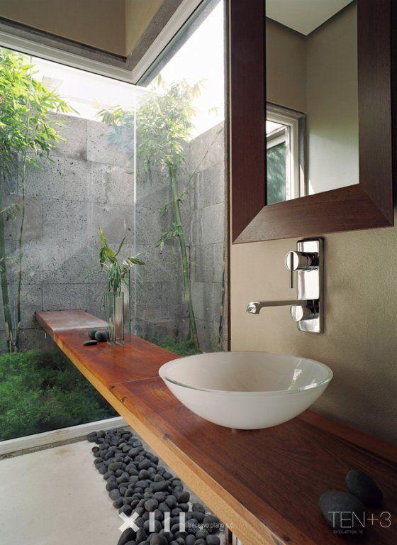 Love these little garden windows for below ground bathrooms