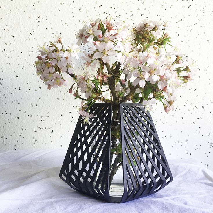 candle holder transformed into vase, styled with pink cherry blossoms picked in the wild