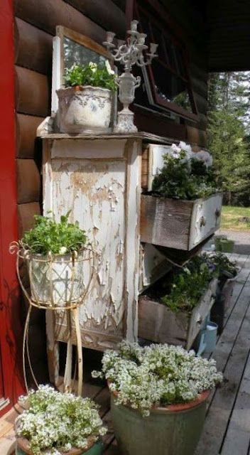 Shabby...chest of flowers. Use chest of drawers off back porch in potting