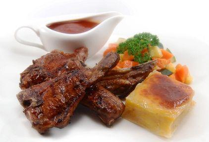 Grilled N.Z. LAMB CHOP, served with pomme gratin & regular vegetables, in smoky BBQ sauce.