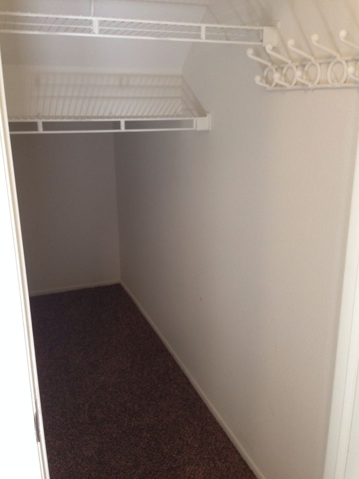 Coat closet - under the stairs, to the right of the guest bath, across from the laundry room