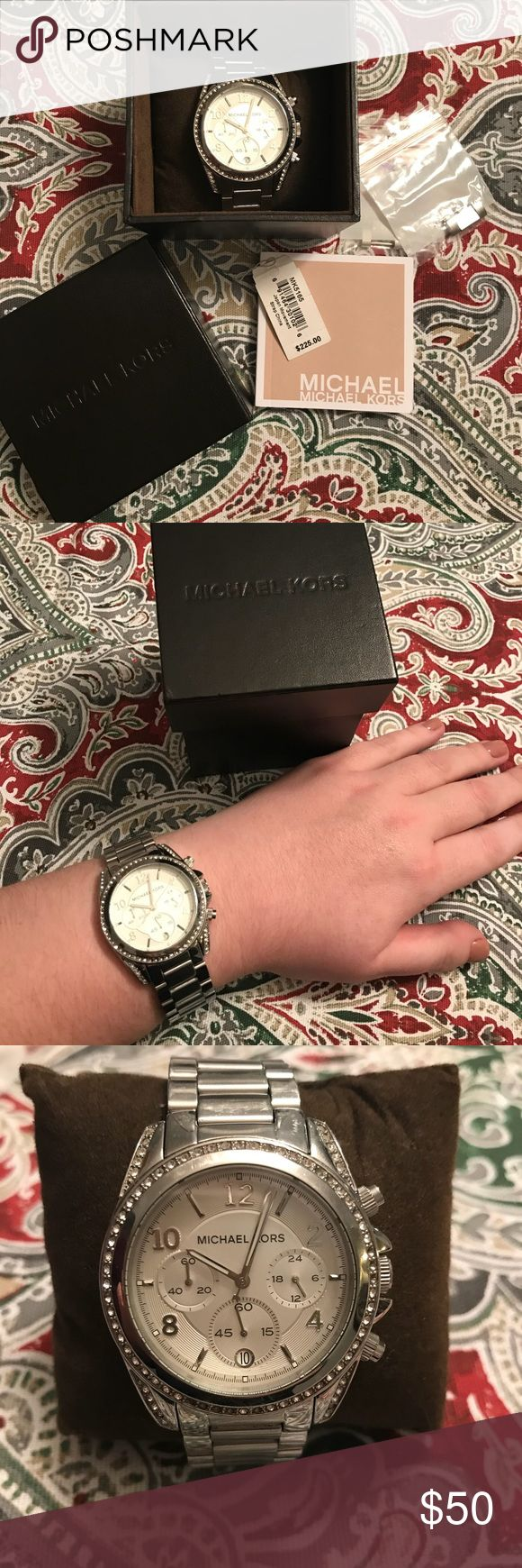 Michael Kors silver watch Michael Kors sterling silver watch Extra links to make watch bigger included  Links are easily removable to make smaller as well A few rhinestones are missing, but not noticeable MICHAEL Michael Kors Jewelry