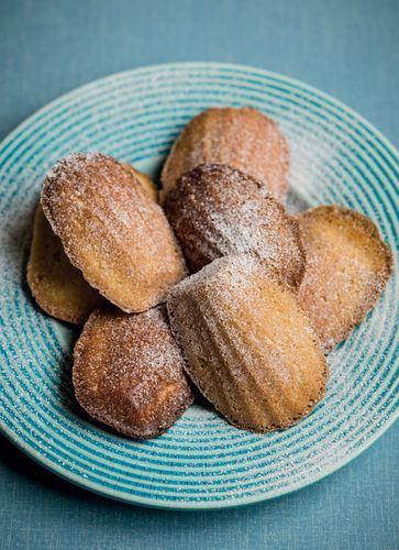 We love these pretty little lemon and honey madeleines from Lindsey Bareham's The Trifle Bowl and Other Tales warm from the oven. They erupt, Vesuvius-like, as theybake but it is the ridged underside that gives them their distinctive puppypaw look. Eat them as they are, or dusted with icing sugar. Delicious with a cuppa or a cappuccino, they also go with jelly, milk puddings and ice cream.